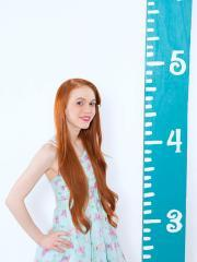 Redhead teen Dolly Little teases in her socks and panties