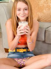 Redhead teen Ava Hardy strips for you with a glass of milk