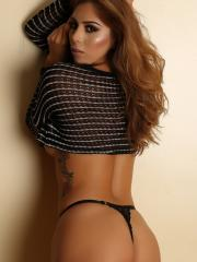 Theresa Erika shows off her tight body in a skimpy crop top