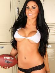 Danielle scores a touch down with her skimpy ripped top and panties