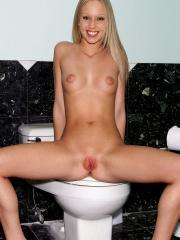 Brea Benett plays with her wet pussy in the bathroom