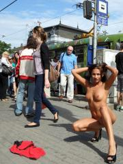 Pictures of hot nude model Michaela Isizzu getting naked on a public street