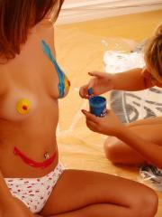 Pitures of Sarah Peachez and her friend playing with the body paint