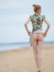 Blonde teen Inga shows you what's under her dress outside