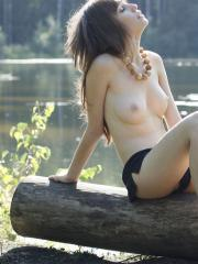 Brunette model Lena strips naked for you by the river