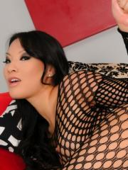 Asa Akira plays with a but plug in her fishnets