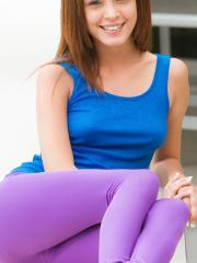Brunette teen Ashley Doll does yoga in her sexy purple pants