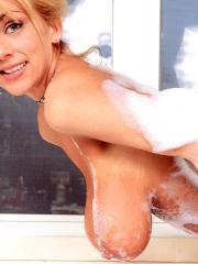 Blonde babe Autumn Jade gets her huge boobs all soapy for you