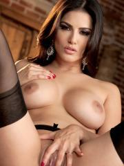 Brunette beauty Sunny Leone spreads her legs to show you her tight pussy