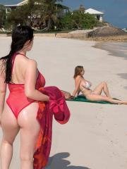 Busty girl Angela White makes out with her girlfriend on a beach