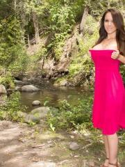 Busty girl Bryci has some fun with her boobs and pussy by the river