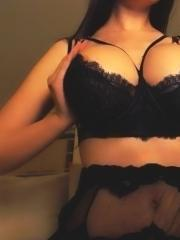 Katherine Knowles teasing in black lingerie and stockings