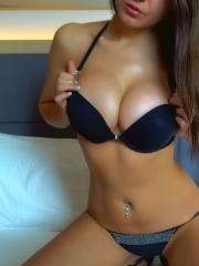 Webcam model Wanda teases in a black rhinestones thong
