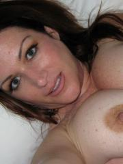 Chubby freckle covered girlfriend takes selfshot pictures of her huge natural tits