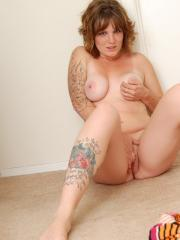 Redhead alt girl Jen strips naked and touches herself