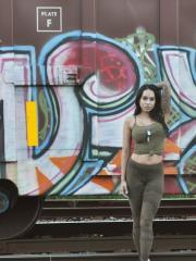 Busty tattooed babe Cindy Cupcakes shows off her form on the rail tracks