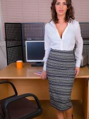 Busty brunette babe Katie L strips out of her work clothes at the office