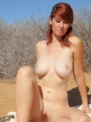 Redhead girl Ashlyn Brooks invites you on a private picnic on the beach