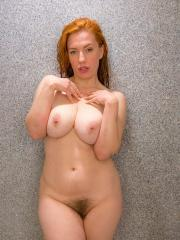 Busty redhead Titania gets all soapy for you in the shower