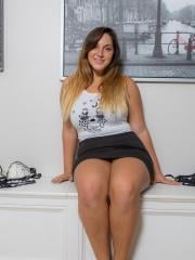 Brunette hottie Allie Giovanni teases and flashes in her skirt