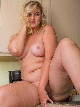 Busty girl Carrie gets naked for you in the kitchen