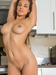 Hot girl Natalia gets naked for you in the kitchen