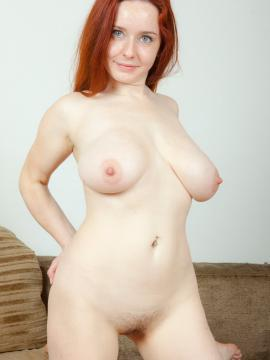 Busty ginger Sara Nkol gets naked for you