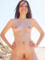 Brunette coed Fey Martin gets naked on a hike