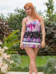 Redhead beauty Ivy Jane strips for you outside