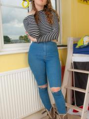 Busty coed Kia Logan strips out of her jeans