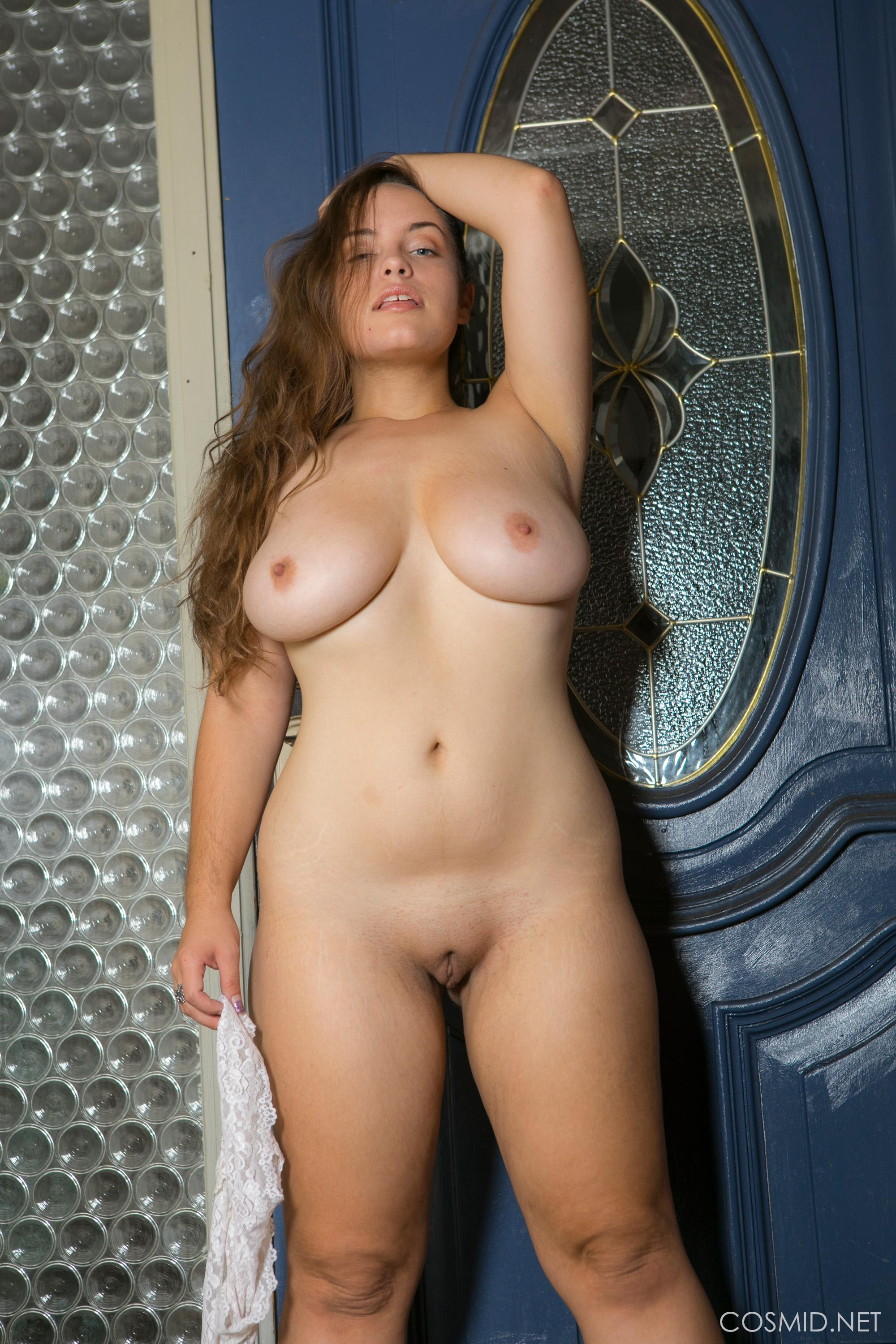 Busty girl Sophie Barnes strips for you in the doorway ...