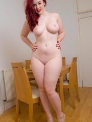 Busty redhead babe Jessica peels off her yellow dress