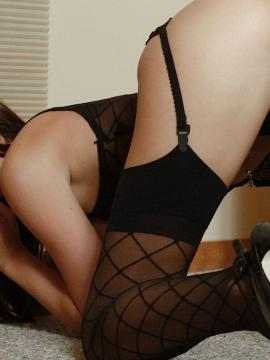 Sexy young Destiny Moody seductively undressing in sheer black stockings and garters