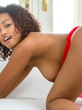 Ebony babe Noel Monique strips out of her red dress
