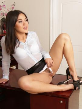 Kendra Spade puts out on her desk