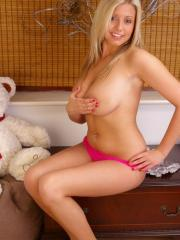 Pictures of big boobed teen Emily in a sexy silver corset and pink panties