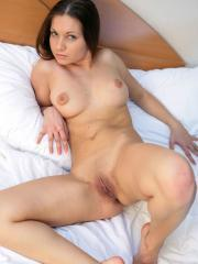 Busty brunette Paris B strips and spreads for you in bed