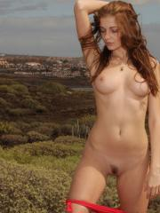 Stunning redhead Indiana A strips for you in the desert