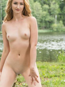 Beautiful girl Leda A poses nude in her sandals by the lake