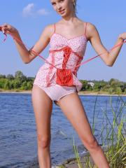 Pictures of gorgeous girl Vika D stripping out of her lingerie by the water