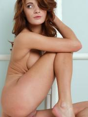 Pictures of redhead girl Petra G displaying her tight nude body