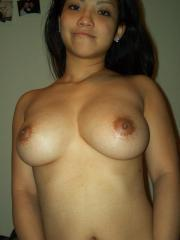 Busty asian GF shows off her round titties on the beach and at home