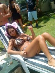 Busty latina hottie shows off her body in a bikini at a party