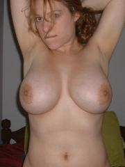 Busty amateur girl takes naughty pics at home