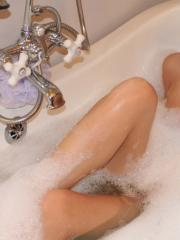 Perky blonde girl next door Becky teases with her perfect tits in her bubble bath