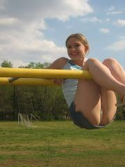 Perky girl next door Shelby shows off her perfect teenage breasts in the park on the jungle gym