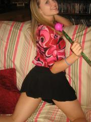 Horny petite teen Shelby strips naked and plays with her pink baton