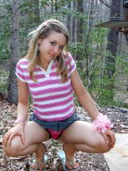 A horny Shelby loves to tease a she flashes her perky tits and tight teen pussy at the park