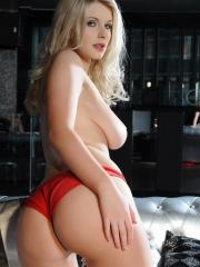 Blonde beauty Jess Davies strips for you on a silver couch