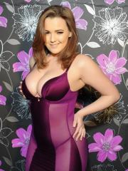 Jodie Gasson pulls down her purple lingerie to expose her beautiful boobs